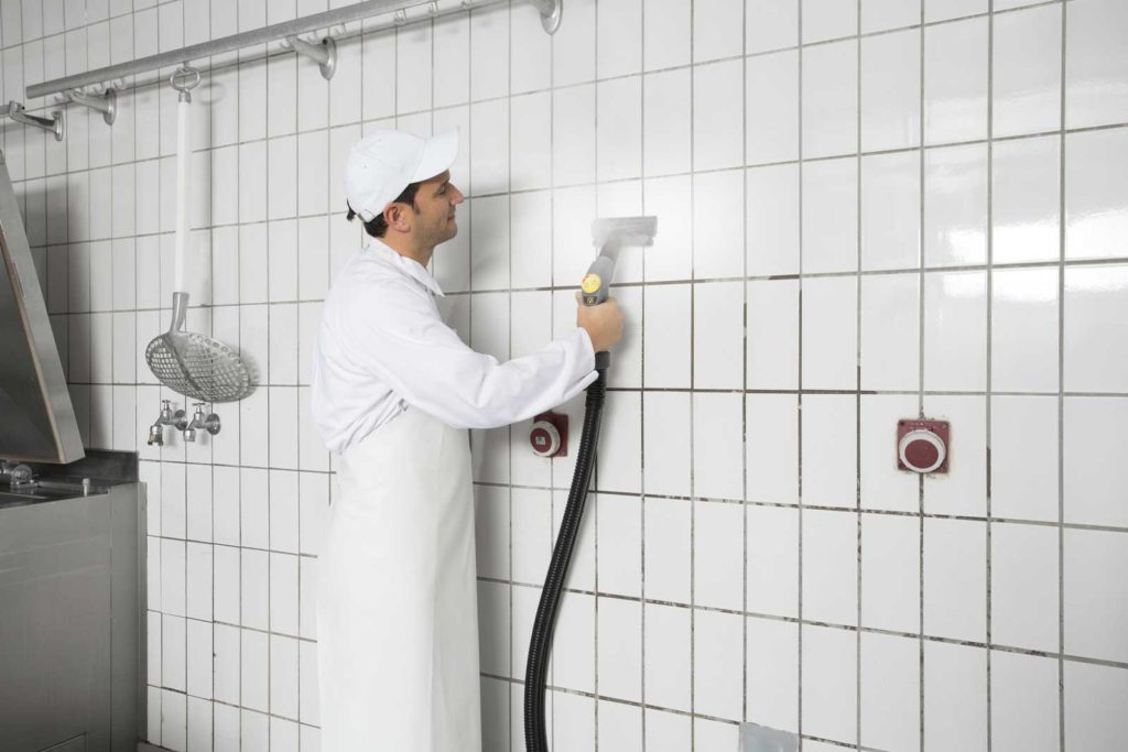 Cleaning kitchen tiles with steam cleaner
