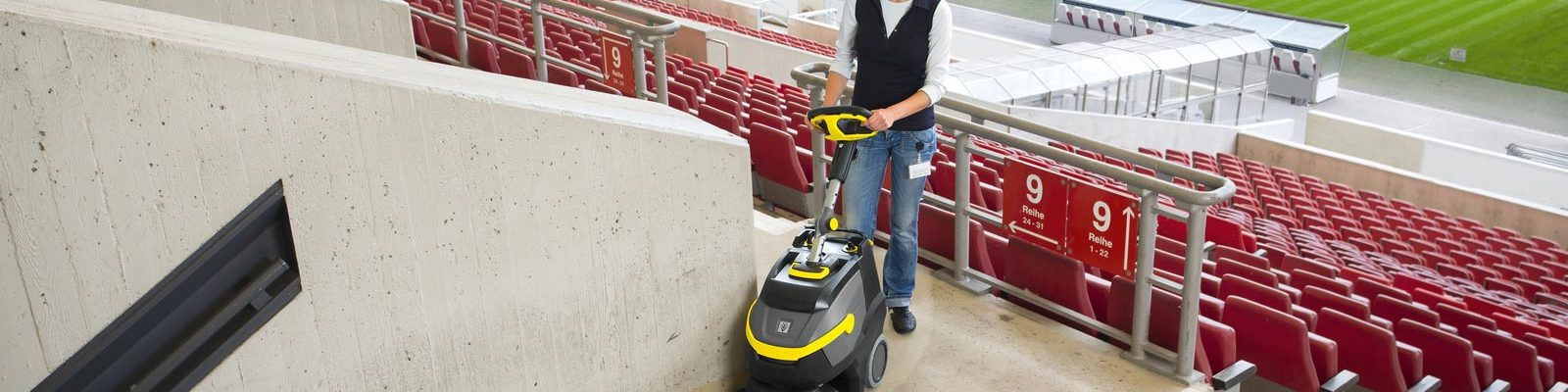 Scrubber dryer cleaning a football stadium