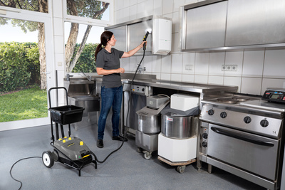 Steam cleaner cleaning a kitchen