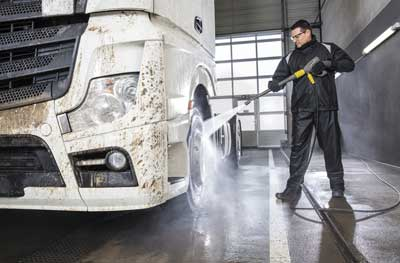 Power washing a delivery HGV truck