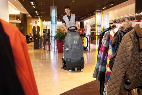 Step on scrubber dryer in a shop