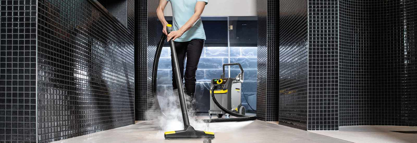 Steam cleaning a gym or pool tiled floor