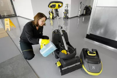 Loading disinfectant into a scrubber dryer