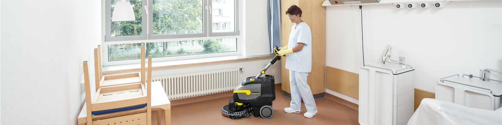 Scrubber dryer cleaning a hospital floor