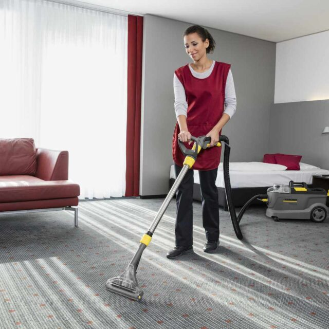 Puzzi 10/2 cleaning a hotel carpet