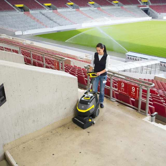 Scrubber dryer cleaning a sports stadium